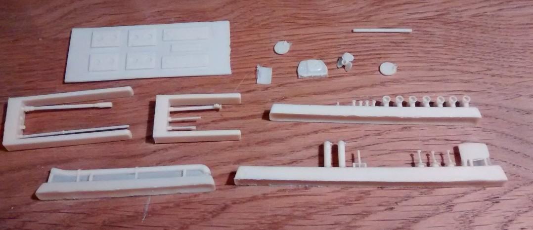 Die Kleinteile aus dem Resin-Bausatz des Bronekater BK-1125.