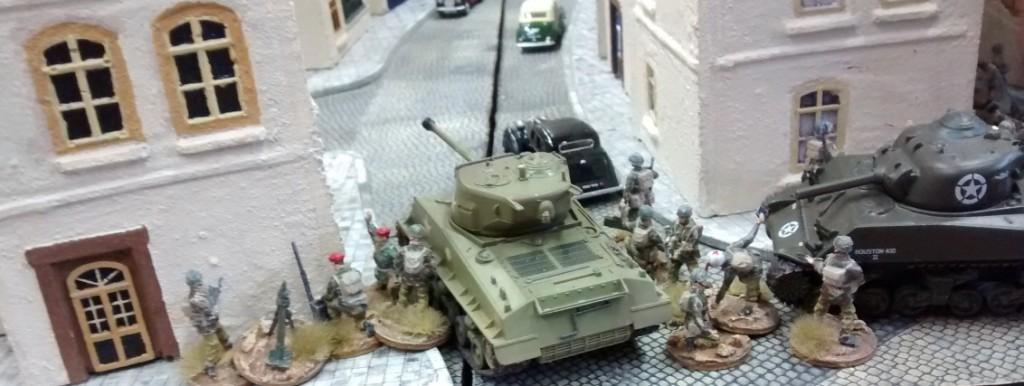 Bei Sofageneral Lucas schwenken die Truppen auf die Hauptausfallstraße an der Bürgermeisterei ein. Die erste Begegnung mit dem Feind naht.
