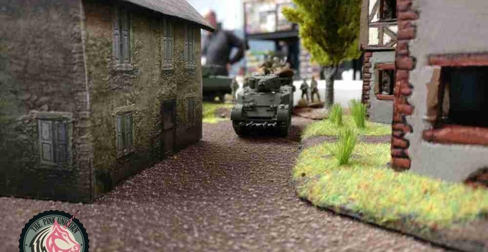 Auf britischer Seite beginnt man mit dem Vorstoß. Ein M5 Stuart setzt in der Deckung eines Hauses nach vorne. ( Behind Omaha. Forum / Spielbericht )