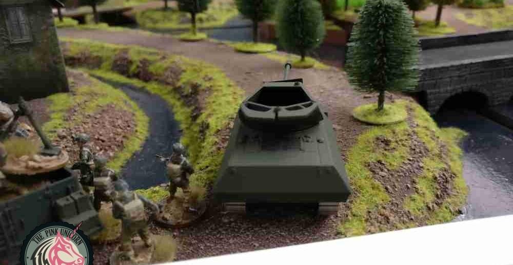 Auch ein Panzerjäger steht bereit. Allerdings wird er dem M5 Stuart und dem Infanterietrupp keine Feuerunterstützung leisten, sondern mehr Richtung Plattenmitte vorgehen. Man plant, von der Plattenmitte aus alle Randzonen der Schelde domimieren zu können. ( Behind Omaha. Forum / Spielbericht )