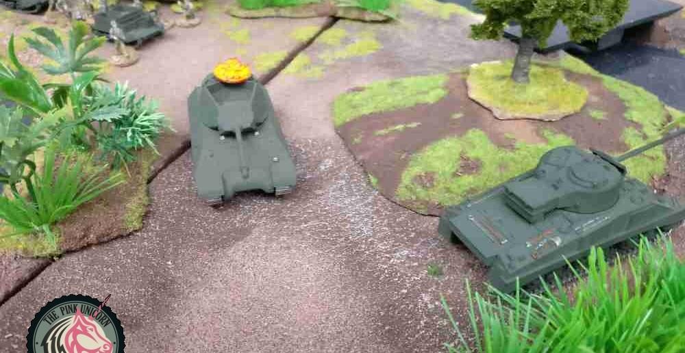 Der letzte im Kampf um das Dorf verbliebene Jagdpanzer erhält einen Treffer non den im Dorf mittlerweile in Feuerreichweite gekommenen deutschen Granatwerfern. Die wirken bei dem offenen Aufbau des Jagdpanzers natürlich fatal. ( Behind Omaha. Forum / Spielbericht )