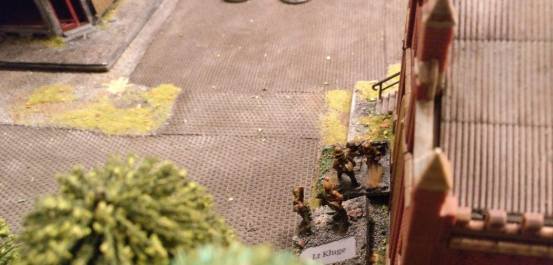 Die Überbleibsel des Granatwerfer-Trupps sammeln im Lagerhaus.
