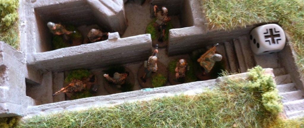 Der Grenadier-Trupp im Bunker erwartet sekündlich den Pfiff zum Sturmangriff.