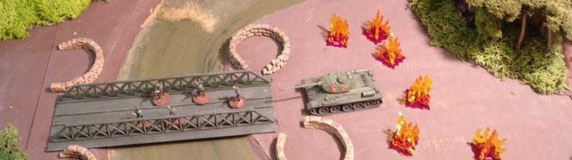 Wenngleich die Sandsackstellungen der US Marines verlassen sind, liegt der T-34 hier unter Beschuss aus der Luft.