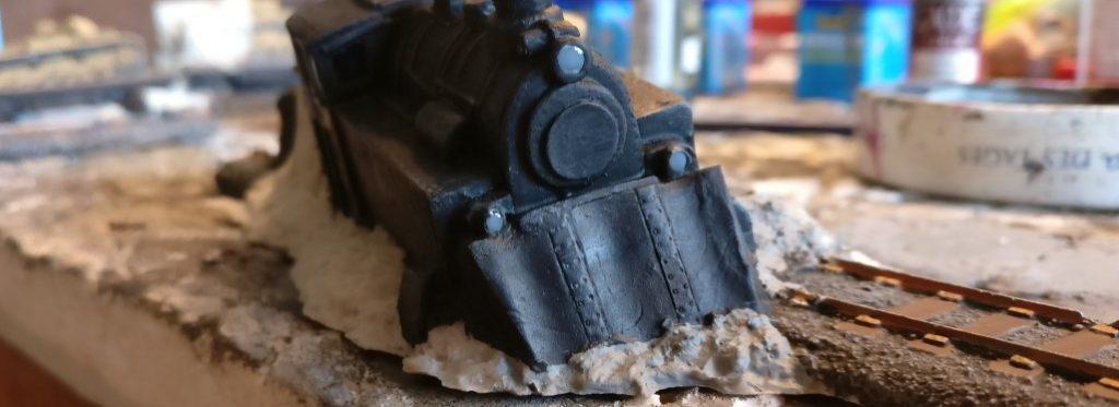 Die Scheinwerfer werden erst mit einem Tupfen Grau und mit glänzendem Klarlack zum Scheinwerfer gemacht.