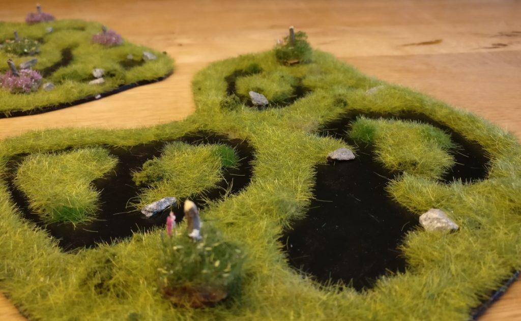 Einige  Feature Equivalents Boggy Flat Ground mit aufgesetzten Buschbasen.