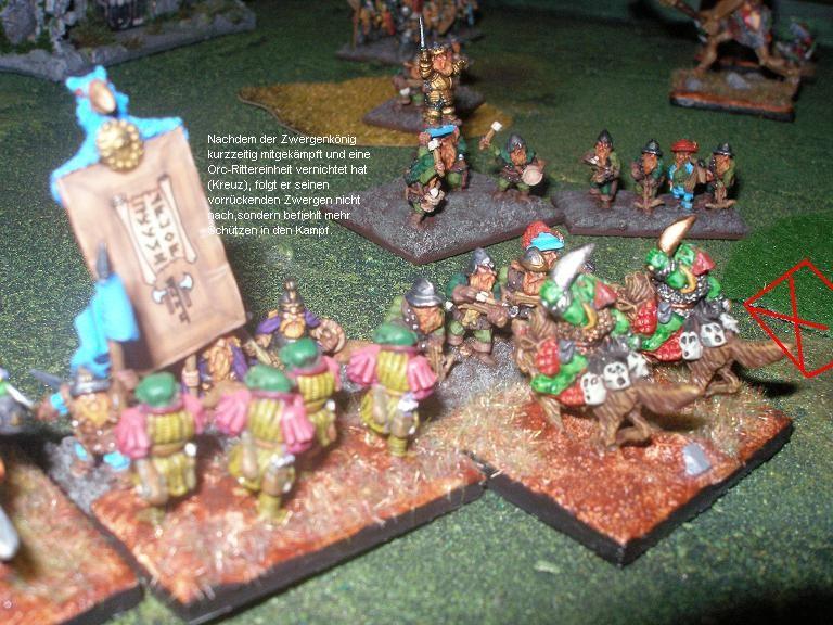 Der König der Zwerge nimmt selbst am Kampf teil und vernichtet eine Rittereinheit der Orks. Doch dann zieht er sich zurück und schickt zusätzliche Schützen in den Kampf.