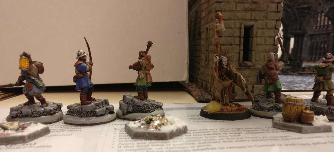 Zur Strecke gebracht: auch wenn der Magier nicht überlebte: drei seiner Gefolgsleute konnten je einen Schatzmarker erjagen und an den Spielfeldrand retten Frostgrave auf dem Tag der offenen Tür des Civitas Mattiacorum in Wiesbaden.