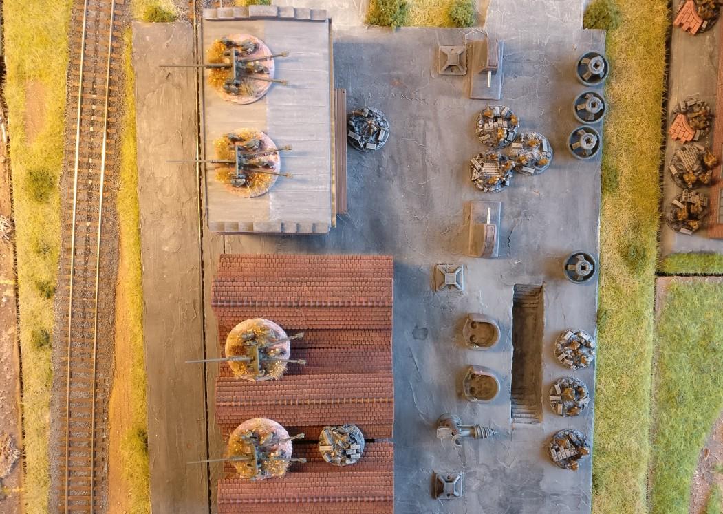 Im Zentrum der zweiten Verteidigungslinie liegen vier 57mm Paks, denen für die Nahverteidigung ein Infantry Platoon mitgegeben wurde.