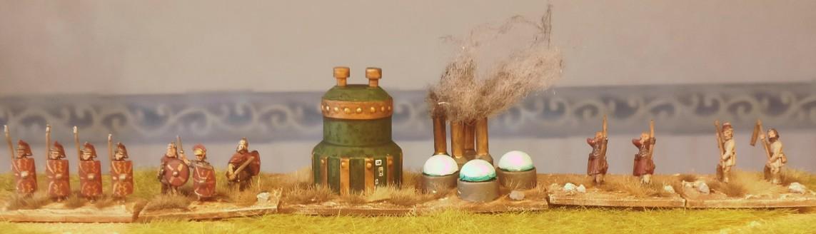 """Die Anlage im Einsatz. Aus den Schloten der Esse steigt Rauch auf.  Der """"Photonenakkumulator""""  ist in Betrieb!"""
