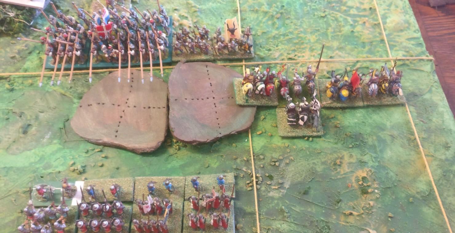 Die Französischen Ritter begegnen den Schweizern. Hier wurde versäumt, die anschließende Bewegung der Schweizer einzuberechnen und eine Drehung auszuführen, die einen geballten Flankenangriff ernöglicht hätte.