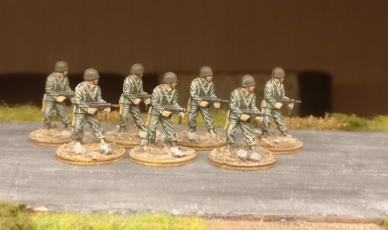 Die dritte der drei Gruppe mit grünen Uniformen.