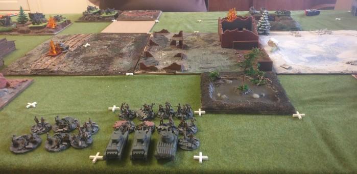 Zentrum des Spielfelds: ein PBI Infantry Platoon der 1. NKWD Division hat die Aufgabe, sich durch die Gebäude durchzuarbeiten.