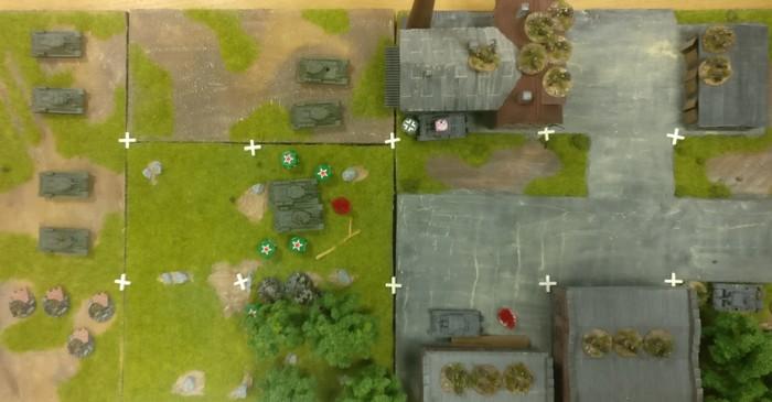 Der rote Pinmarker , die zerstörten T-34 und die grünen Würfel als Casualty Marker machen den Fortschritt des Spiels deutlich.